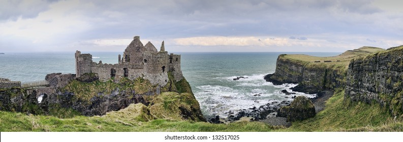 A panorama with details from the famous Dunluce Castle back lit - a landmark from County Antrim, Northern Ireland.
