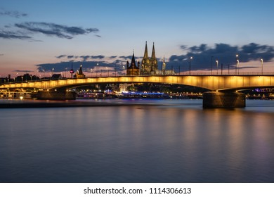 Panorama with the Deutzer bridge at night during the blue hour, in the background the Cologne Cathedral.