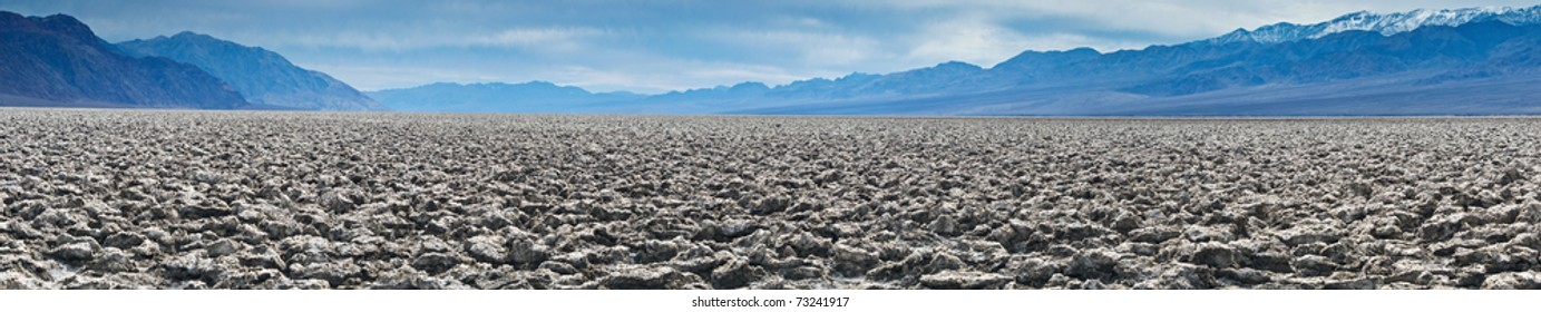 Panorama of Devil's Golf Course in the Badwater Basin.  The Devil's Golf Course is a large salt pan on the floor of Death Valley in the Badwater Basin.