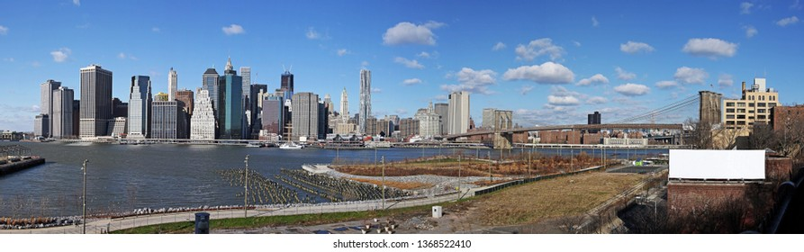 Panorama of downtown Manhattan with a blank billboard on a side.