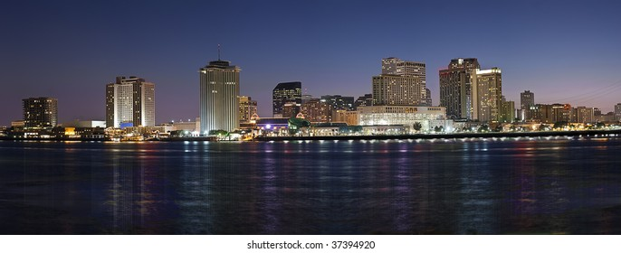 Panorama of downtown New Orleans after sunset from across Mississippi River