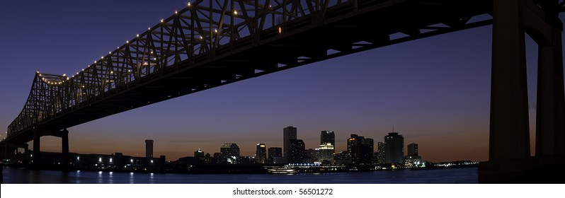 Panorama of downtown New Orleans after sunset with Mississippi River bridge