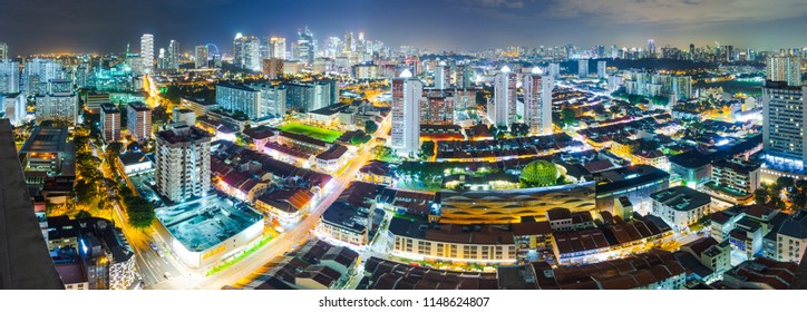 Panorama of downtown Singapore with Business district, Little India and Flyer wheel, at night