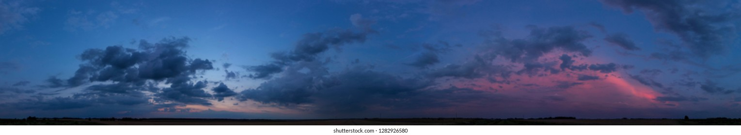 Panorama of dramatic sunset sky with clouds