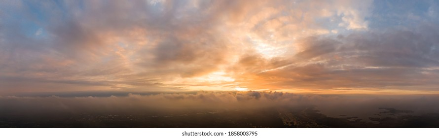 Panorama of Dramatic vibrant color with beautiful cloud of sunrise and sunset. Panoramic image