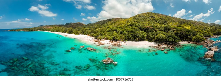 Panorama drone view over the island Praslin, bird eye view panoramic tropical island with crystal clear water Praslin Seychelles