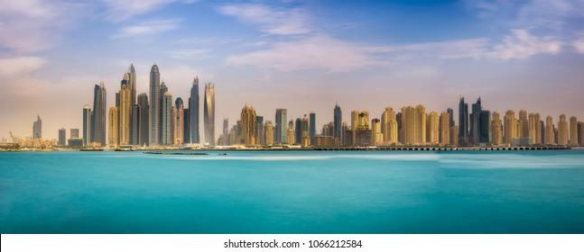 Panorama of Dubai Marina photographed from The Palm Jumeirah. Long exposure.