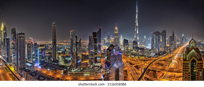 Panorama of Dubai skyline during sunset with shining traffic road, United Arab Emirates.