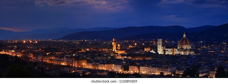 Panorama of Duomo Santa Maria Del Fiore, tower of Palazzo Vecchio and famous bridge Ponte Vecchio at night  in Florence, Tuscany, Italy