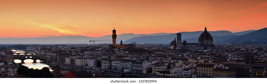 Panorama of Duomo Santa Maria Del Fiore, tower of Palazzo Vecchio and famous bridge Ponte Vecchio at sunset  in Florence, Tuscany, Italy