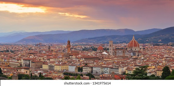 Panorama of Duomo Santa Maria Del Fiore and tower of Palazzo Vecchio at sunset  in Florence, Tuscany, Italy