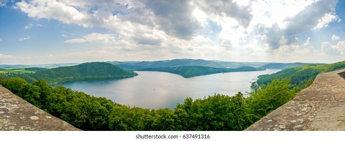 Panorama of Edersee Germany green trees blue sky clouds