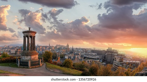 Panorama of Edinburgh against sunset with Calton Hill and castle in Scotland