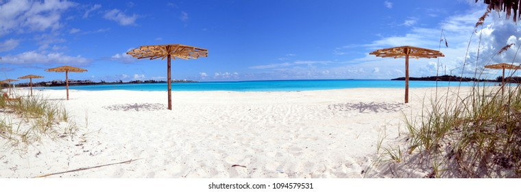 panorama of Emerald Bay beach on Grand Exhuma Bahama with sugar white sand and the Caribbean blues