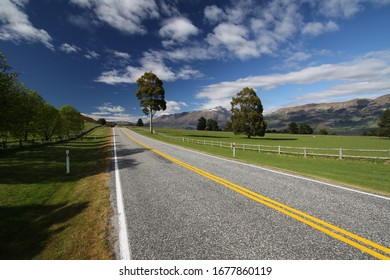 panorama from a empty, lonely road in new zealand during a hot summer day