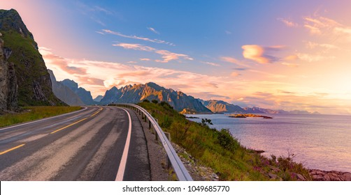 Panorama of empty winding country road in Norway, Europe, Scandinavia. Auto travel on sunset. Blue sky with clouds and mountains. Lofoten islands.
