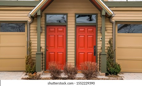 Panorama Entrance of townhouses with vibrant glass paned front doors and garage doors
