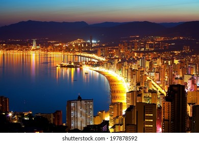 Panorama of evening city with deserted beach (Spain, Costa Brava)