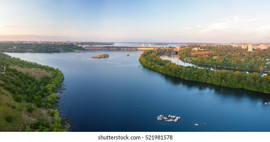 Panorama of evening Dnieper river with Dneproges hydroelectric dam in Zaporozhye, Ukraine, view from the 100 m height