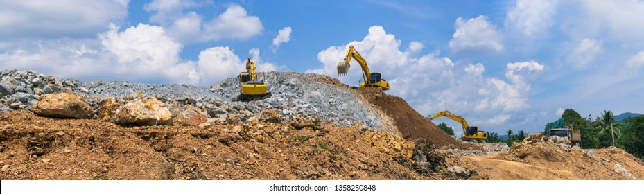 Panorama, Excavator, Backhoe and rock crushing machine of mining under a blue sky with clouds