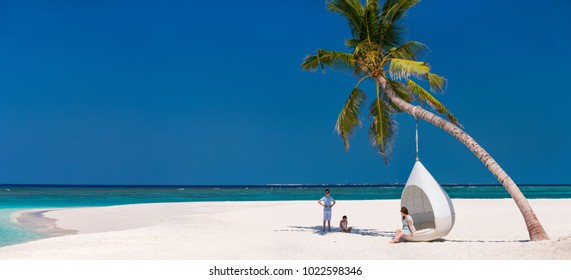 Panorama of family mother and kids enjoying tropical beach vacation
