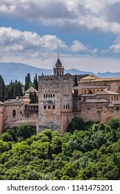 Panorama of the famous Alhambra - mediaeval Moorish palace and fortress complex from Mosque of Granada. Alhambra originally constructed as a small fortress in AD 889. Granada, Andalusia, Spain.