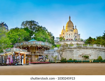 Panorama of the famous basilica of Sacre-Coeur in Montmartre, Paris at sunset with carousel horse ride, no people