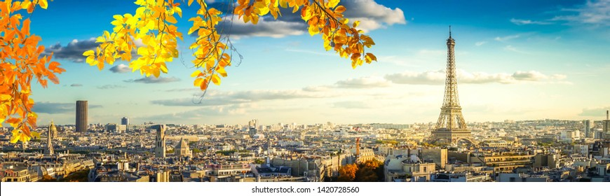 panorama of famous Eiffel Tower and Paris roofs, Paris France, at fall
