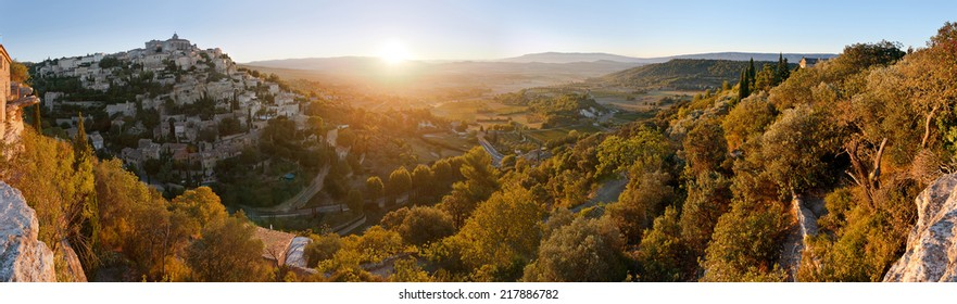 Panorama of famous Gordes medieval village and provencal countryside sunrise view, Provence, France