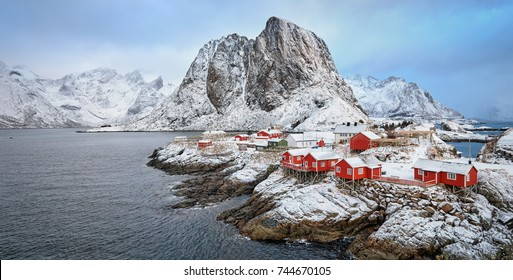 Panorama of famous tourist attraction Hamnoy fishing village on Lofoten Islands, Norway with red rorbu houses in winter