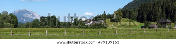 Panorama of farm with small church on the hill in Austria