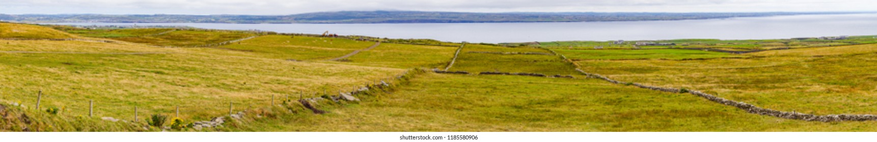 Panorama of Farms field in Cliffs of Moher with Lahinch and Licannor villages in background, Doolin, Clare, Ireland