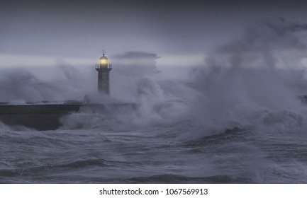 Panorama of Felgueiras lighthouse with giant waves breaking during a storm. Porto, Portugal.
