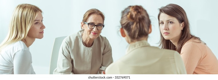 Panorama of female psychologist helping her stressed and depressed patients