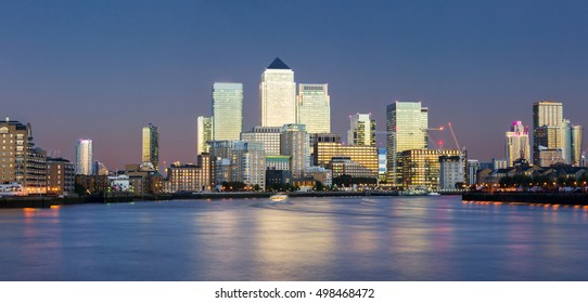 Panorama of the financial district Canary Wharf in London after sunset