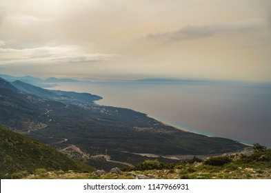 Panorama foggy coast of the Ionian Sea. Nature and travel. Albania, Vlora County, Dhermi Beach, near Llogara pass