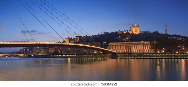 Panorama of footbridge Passerelle Palais du Justice over the Saone river in Lyon during twilight.