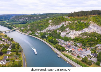 Panorama with fortress and Meuse river in Ardennes. Cruise boat on river Meuse with Poilvache Castle ruins on cliffs. Riverside village Houx in Yvoir near Dinant and Namur, Ardennes, Wallonia, Belgium