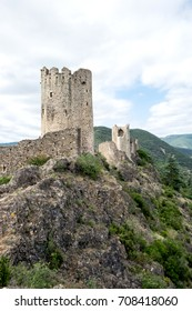 Panorama of four ruined medieval cathar castles called Lastours. They are lost in Pyrenean mountains in France.
