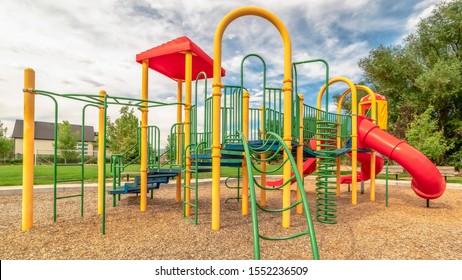 Panorama frame Colorful playground equipment with tube slide bridge climbing bars and stairs
