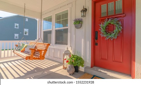 Panorama frame Front porch of modern home with swinging chair