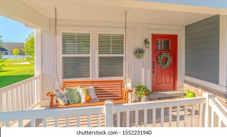 Panorama frame Front porch of traditional home and swinging chair