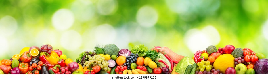 Panorama fresh fruits and vegetables on green background. Collage for skinali (glass panel)