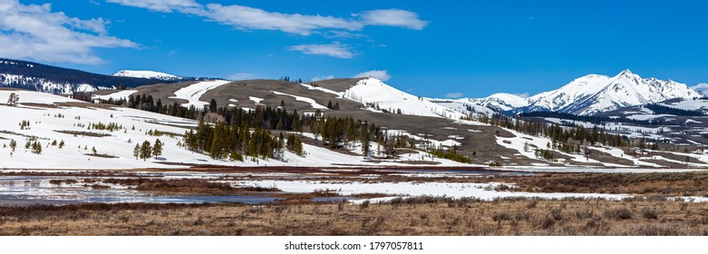 Panorama of Frozen Yellowstone Lake Surrounded by Rocky Mountains in Yellowstone National Park, Wyoming, USA