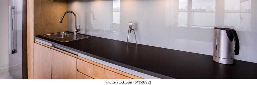 Panorama of functional kitchen interior with solid fixture