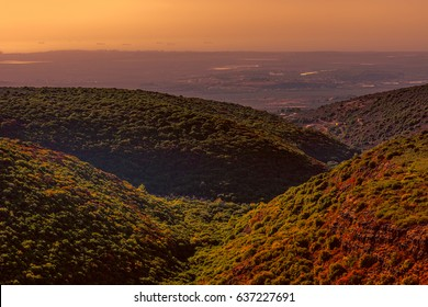 Panorama of Galilee- the Northern District of Israel at sunset. Aerial view of Galilee mountains and Mediterranean sea