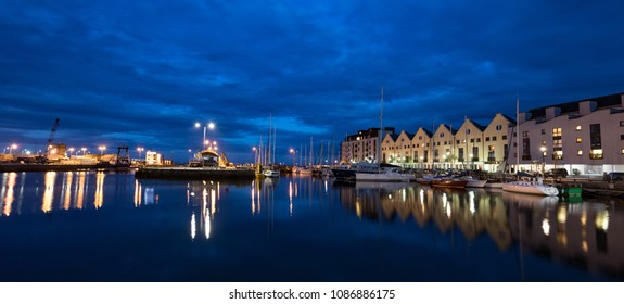 Panorama of Galway city harbour docklands illuminated at night
