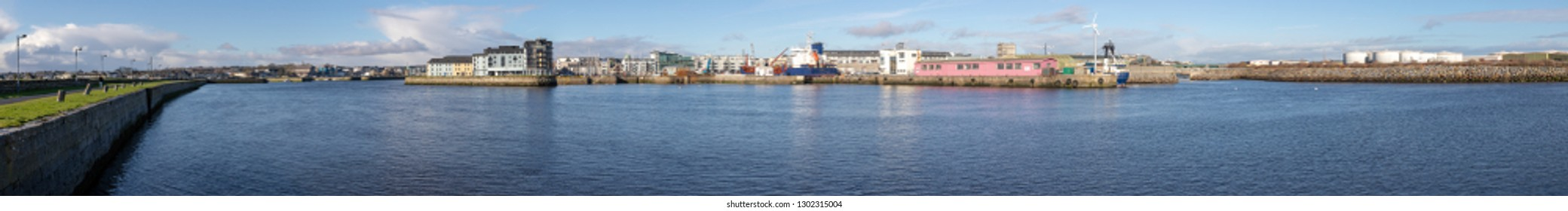 Panorama with Galway harbour, Corrib river and Galway buildings with reflection, Galway, Ireland
