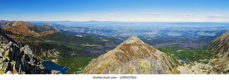 Panorama of  Gasienicowy Black Pond, Zolta Turnia Peak and Red Pond from Skrajny Granat Peak, high Tatra mountains, Poland