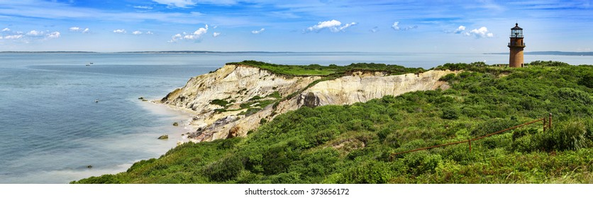 Panorama of a Gay Head lighthouse on a cliff in Aquinnah, Marthas Wineyard